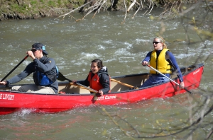 3 people paddling